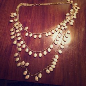 Three strand flat pearl necklace